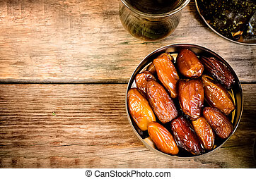 dates  on the dark wood background. toning.