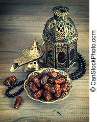 Dates, oriental lamp, lantern and rosary. arabic holidays...