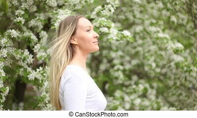 Dating among apple-trees - A woman standing among apple...