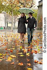 Dating couple in Paris at rain