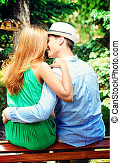 dating couple - Young people tenderly kissing on a park...