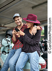 Dating of interracial couple - Laughing interracial couple...
