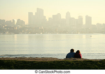 Dating - A dating couple enjoying sunset and downtown view
