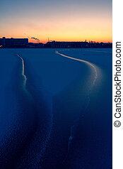 Daugava river in Riga in ice at sunset