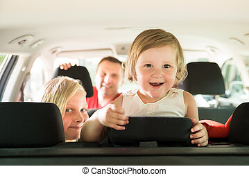 Daughter And Her Family Traveling By Car. Outdoors Shot