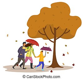 Daughter, dad and mom walking in autumn park with umbrellas, yellow tree, leaf fall. Rainy weather