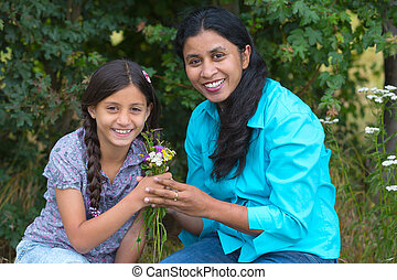 Daughter gives flowers to her mother