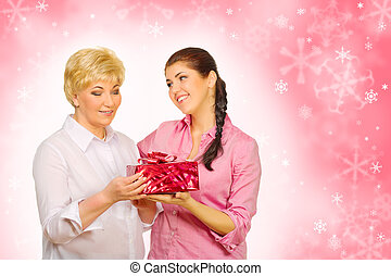 Daughter giving gift to her mother