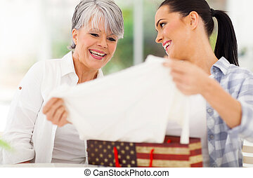 daughter giving her senior mother present