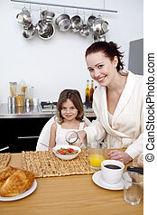 Daughter having breakfast with her mother