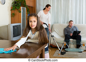 Daughter helping mother to clean - European daughter helping...