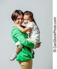 Daughter hugging her mother