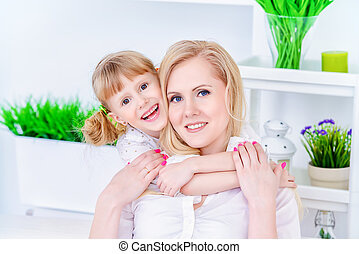 daughter hugging mom - Happy family spending time together....