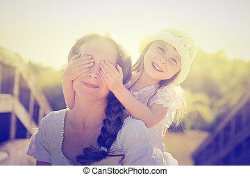 Daughter hugging mother.