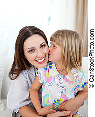 Daughter Kissing her mother on bed