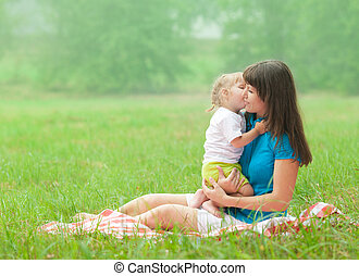 daughter kissing mother with love