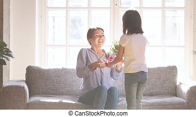 Daughter make surprise for happy mom congratulate with...