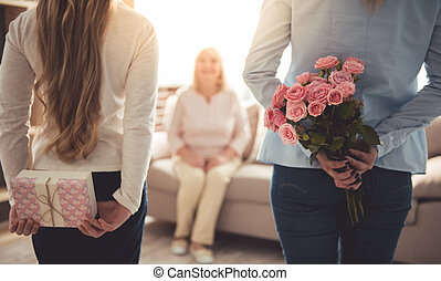 Daughter, mom and granny - Teenage girl and her mom are...