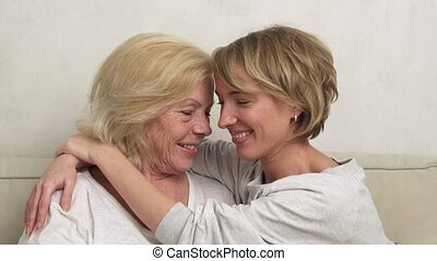 daughter mother hugging and smiling - Happy adult daughter...
