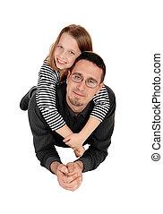 Daughter piggyback on dad.