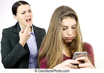 Daughter playing with cell phone while mother is shouting