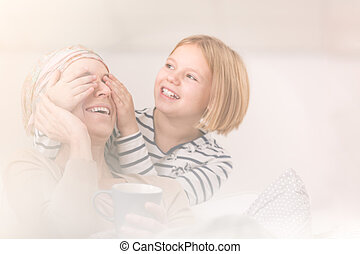 Daughter playing with sick mother