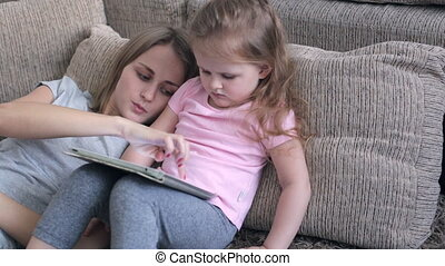 Daughter playing with tablet