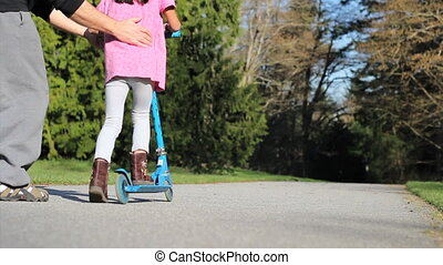 Daughter Rides Scooter