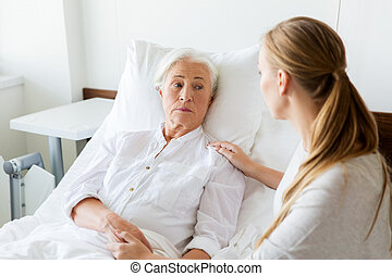 daughter visiting her senior mother at hospital