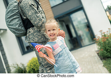 Daughter walking home with daddy returning from military service