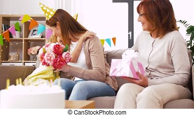 daughter with gift box greeting mother on birthday - family,...