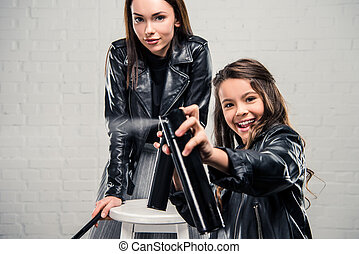 Daughter with hair spray - stylish Smiling Daughter pressing...
