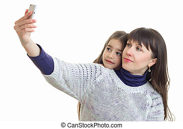 daughter with her mother makes selfie