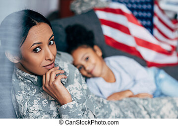daughter with mother in military uniform