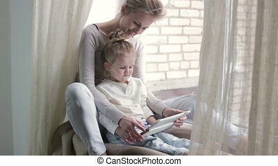 Daughter with mother using tablet