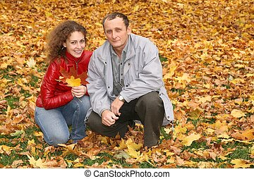 daughter with the father in the park in autumn