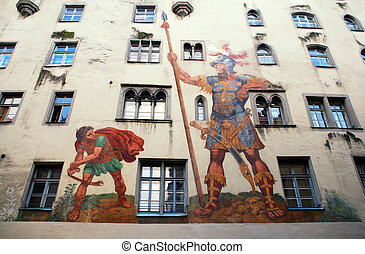 David and Goliath fresco on medieval house wall, Regensburg, Bavaria, Germany. Medieval center of Regensburg is a UNESCO World Heritage Site.