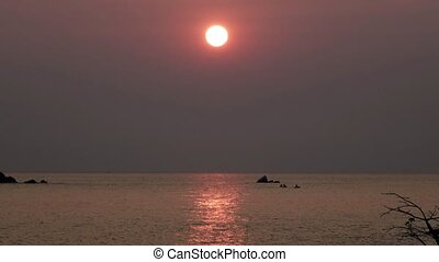 Dawn at lake malawi with traditional fisherman over wooden boats