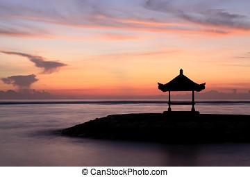 Dawn at Sanur, Bali - A Balinese Pagoda on the beach at...