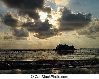 Dawn at sea at low tide