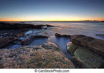 Dawn coast on the rocks at Cronulla, Australia
