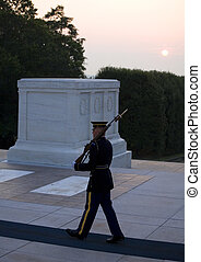 dawn guard duty - sentry standing guard in the morning at...
