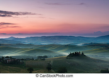 Dawn in Tuscany - White fog and purple clouds on a beautiful...