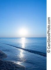 Dawn of the sun on the sea calm seascape