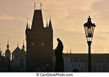 Dawn on the Charles Bridge in Prague.