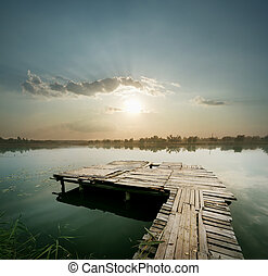 Dawn on the lake with pier