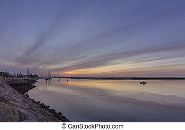 Dawn seascape view of Olhao Marina, waterfront to Ria...