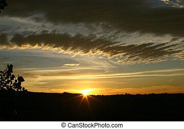 Dawn - The sun just peeking over the horizon at the start of...