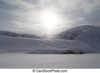 dawn sun in the snowy mountains of Kazakhstan