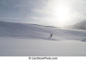 dawn sun in the snowy mountains